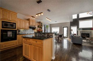 Photo 4: 1302 STRATHCONA Drive SW in Calgary: Strathcona Park Detached for sale : MLS®# C4235711