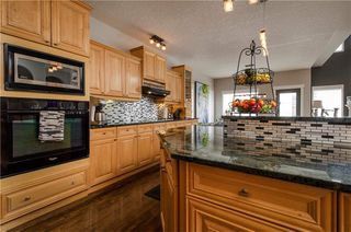 Photo 6: 1302 STRATHCONA Drive SW in Calgary: Strathcona Park Detached for sale : MLS®# C4235711