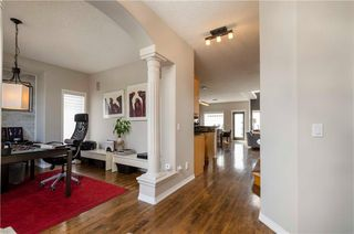 Photo 2: 1302 STRATHCONA Drive SW in Calgary: Strathcona Park Detached for sale : MLS®# C4235711