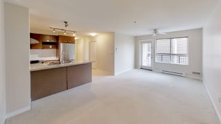"Photo 1: 221 9500 ODLIN Road in Richmond: West Cambie Condo for sale in ""CAMBRIDGE PARK"" : MLS®# R2358525"