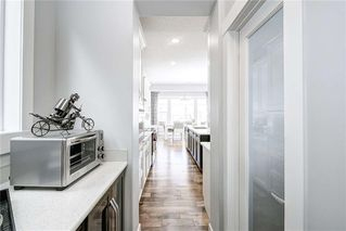 Photo 7: 811 New Brighton Drive SE in Calgary: New Brighton Detached for sale : MLS®# C4300093