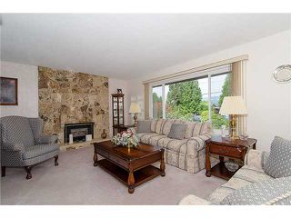 Photo 2: 309 VALOUR DR in Port Moody: College Park PM House for sale : MLS®# V1004140