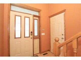 Photo 2: 183 WEST MCDOUGAL Road: Cochrane House for sale : MLS®# C4088134