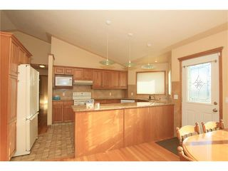 Photo 10: 183 WEST MCDOUGAL Road: Cochrane House for sale : MLS®# C4088134