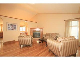 Photo 4: 183 WEST MCDOUGAL Road: Cochrane House for sale : MLS®# C4088134
