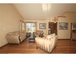 Photo 5: 183 WEST MCDOUGAL Road: Cochrane House for sale : MLS®# C4088134