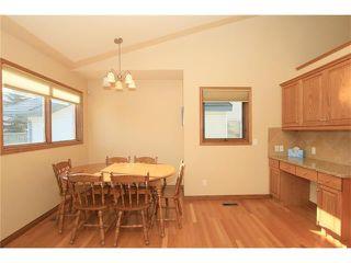 Photo 9: 183 WEST MCDOUGAL Road: Cochrane House for sale : MLS®# C4088134