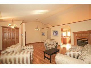 Photo 6: 183 WEST MCDOUGAL Road: Cochrane House for sale : MLS®# C4088134