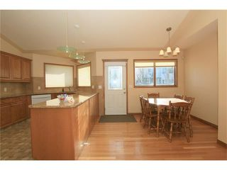 Photo 8: 183 WEST MCDOUGAL Road: Cochrane House for sale : MLS®# C4088134