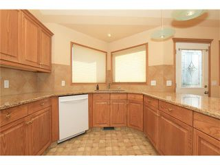 Photo 12: 183 WEST MCDOUGAL Road: Cochrane House for sale : MLS®# C4088134