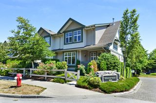 "Photo 1: 1 6050 166 Street in Surrey: Cloverdale BC Townhouse for sale in ""WESTFIELD"" (Cloverdale)  : MLS®# R2291538"