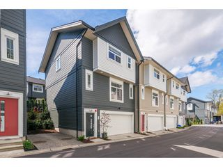 "Photo 1: 76 7665 209 Street in Langley: Willoughby Heights Townhouse for sale in ""Archstone"" : MLS®# R2359787"