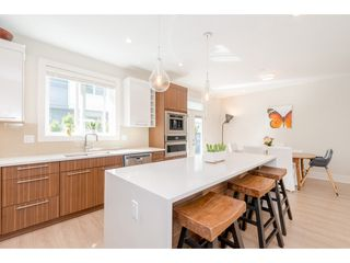 """Photo 8: 76 7665 209 Street in Langley: Willoughby Heights Townhouse for sale in """"Archstone"""" : MLS®# R2359787"""