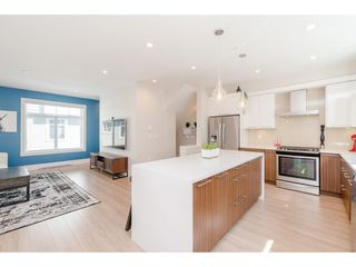 """Photo 9: 76 7665 209 Street in Langley: Willoughby Heights Townhouse for sale in """"Archstone"""" : MLS®# R2359787"""