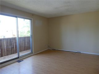 Photo 4: 3 1709 48 Street SE in Calgary: Forest Lawn Semi Detached for sale : MLS®# C4305391