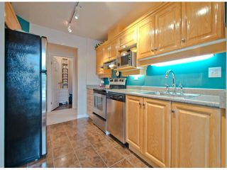 """Photo 3: 301 15272 20TH Avenue in Surrey: King George Corridor Condo for sale in """"WINDSOR COURT"""" (South Surrey White Rock)  : MLS®# F1324967"""