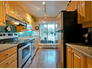 """Photo 2: 301 15272 20TH Avenue in Surrey: King George Corridor Condo for sale in """"WINDSOR COURT"""" (South Surrey White Rock)  : MLS®# F1324967"""