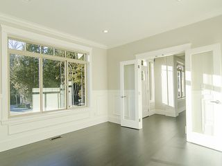 "Photo 7: 3968 ROBIN Place in Port Coquitlam: Oxford Heights House for sale in ""OXFORD HEIGHTS"" : MLS®# V1046329"