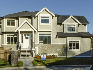 "Photo 1: 3968 ROBIN Place in Port Coquitlam: Oxford Heights House for sale in ""OXFORD HEIGHTS"" : MLS®# V1046329"