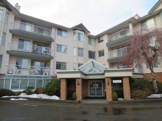 "Photo 1: 102 5363 206 Street in Langley: Langley City Condo for sale in ""PARKWAY 2"" : MLS®# R2130877"