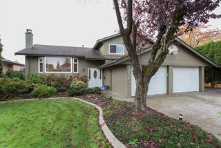 Photo 1: 14516 CHARTWELL Drive in Surrey: Bear Creek Green Timbers House for sale : MLS®# R2141748
