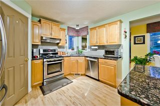Photo 15: EDGEBROOK GV NW in Calgary: Edgemont House for sale