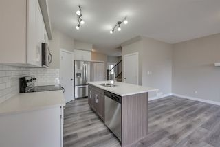 Photo 5: 8565 CUSHING Place in Edmonton: Zone 55 House Half Duplex for sale : MLS®# E4151853