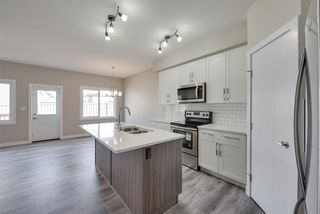 Photo 3: 8565 CUSHING Place in Edmonton: Zone 55 House Half Duplex for sale : MLS®# E4151853