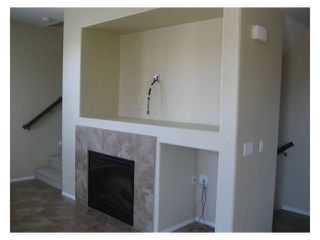 Photo 4: SANTEE Townhome for sale or rent : 3 bedrooms : 1053 Iron Wheel Street