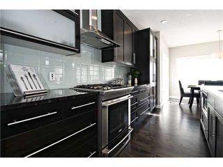 Photo 2: 87 BRIGHTONSTONE Passage SE in CALGARY: New Brighton Residential Detached Single Family for sale (Calgary)  : MLS®# C3620487