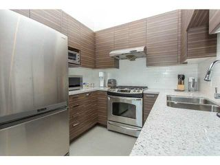 "Photo 4: 407 9388 MCKIM Way in Richmond: West Cambie Condo for sale in ""MAYFAIR PLACE 2"" : MLS®# V1109942"