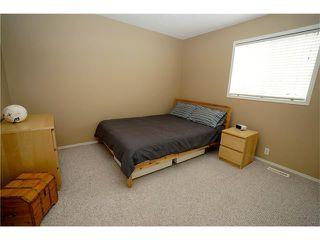 Photo 13: 70 TUSCANY RIDGE View NW in Calgary: Tuscany House for sale : MLS®# C4120066