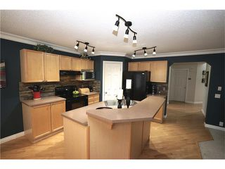 Photo 4: 70 TUSCANY RIDGE View NW in Calgary: Tuscany House for sale : MLS®# C4120066