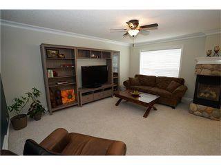 Photo 7: 70 TUSCANY RIDGE View NW in Calgary: Tuscany House for sale : MLS®# C4120066