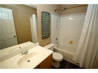 Photo 15: 70 TUSCANY RIDGE View NW in Calgary: Tuscany House for sale : MLS®# C4120066