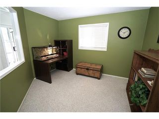 Photo 8: 70 TUSCANY RIDGE View NW in Calgary: Tuscany House for sale : MLS®# C4120066