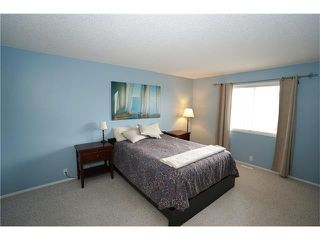 Photo 10: 70 TUSCANY RIDGE View NW in Calgary: Tuscany House for sale : MLS®# C4120066