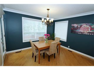 Photo 6: 70 TUSCANY RIDGE View NW in Calgary: Tuscany House for sale : MLS®# C4120066