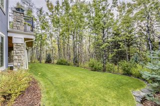 Photo 50: 128 POSTHILL Drive SW in Calgary: Springbank Hill House for sale : MLS®# C418744