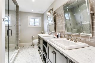 Photo 34: 128 POSTHILL Drive SW in Calgary: Springbank Hill House for sale : MLS®# C418744