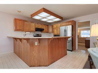 Photo 6: 12353 56 Avenue in Surrey: Panorama Ridge House for sale : MLS®# R2349551