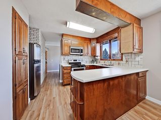 Photo 3: 808 LAKE ONTARIO Drive SE in Calgary: Lake Bonavista Detached for sale : MLS®# C4247313