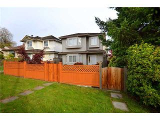 Photo 1: 8338 SELKIRK Street in Vancouver: Marpole House 1/2 Duplex for sale (Vancouver West)  : MLS®# V918484
