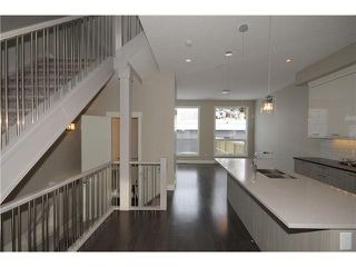 Photo 5: 464 29 Avenue NW in CALGARY: Mount Pleasant Residential Attached for sale (Calgary)  : MLS®# C3594949