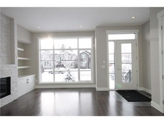 Photo 3: 464 29 Avenue NW in CALGARY: Mount Pleasant Residential Attached for sale (Calgary)  : MLS®# C3594949