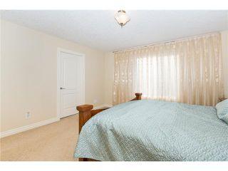 Photo 10: 109 BRIDLERIDGE Heights SW in Calgary: Bridlewood House for sale : MLS®# C3650128