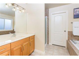 Photo 11: 109 BRIDLERIDGE Heights SW in Calgary: Bridlewood House for sale : MLS®# C3650128