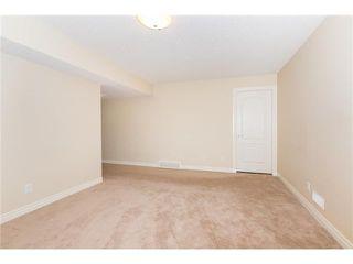 Photo 18: 109 BRIDLERIDGE Heights SW in Calgary: Bridlewood House for sale : MLS®# C3650128