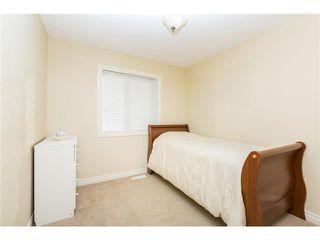 Photo 12: 109 BRIDLERIDGE Heights SW in Calgary: Bridlewood House for sale : MLS®# C3650128