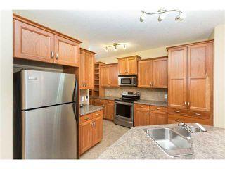 Photo 5: 109 BRIDLERIDGE Heights SW in Calgary: Bridlewood House for sale : MLS®# C3650128